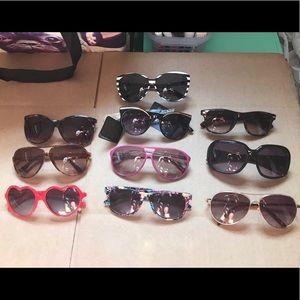 10 used pairs of various women's sunglasses